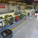 View on our overhaul department with honing machines, a valve seat cutter amongst others.