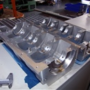 We have machined several cast aluminium crankcases for drag-racing Kawasaki and Suzuki motorbikes. We machined them, drilled oil ducts and line-bored