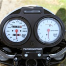 Billet piece for attaching an odometer and tachometer of a Buell